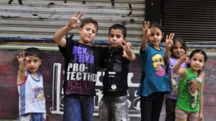 small children posing holding up 3 fingers, celebrating the victory of kidnapping 3 Israeli teens