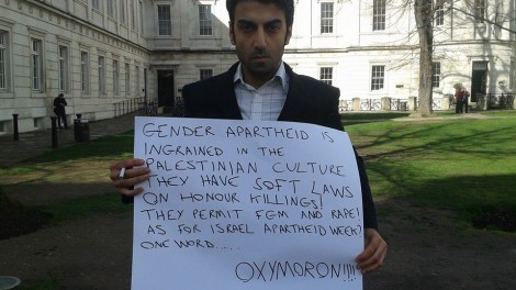 I was told to leave the premises. So I stood outside with this sign. A woman called me 'a jewish pig' and a dirty y*d.