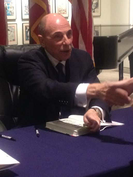 Author Edward Klein signing his book Blood Fued