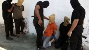 Hamas terrorists 'execute collaborators' in Gaza City (photo: Fox News, free to use & share, even commercially)