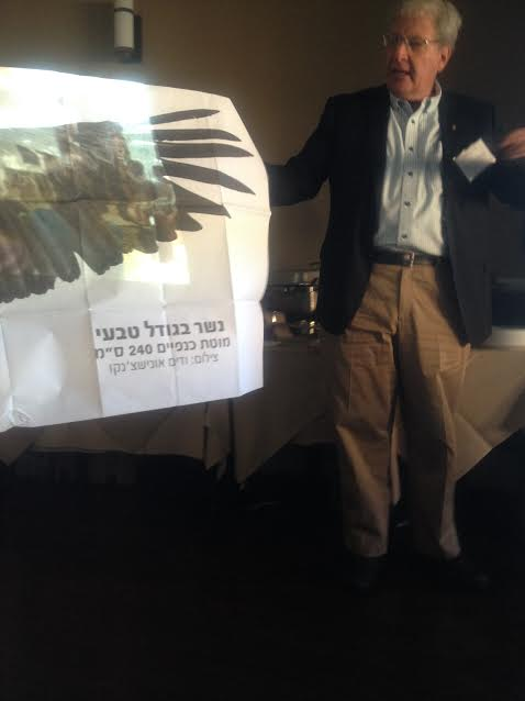Professor Yossi Leshem next to real size eagle banner-Photo by Nurit Greenger