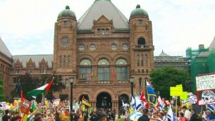 Protesters square off in front of the Provincial Parliament in Toronto, Canada