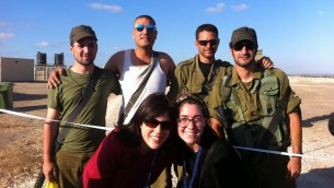 Shari (front left) and a fellow mission participant visiting an Iron Dome installation near Gaza.