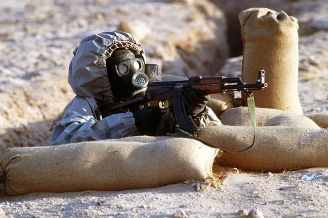 Soldier fighting with a gas mask in Syria.