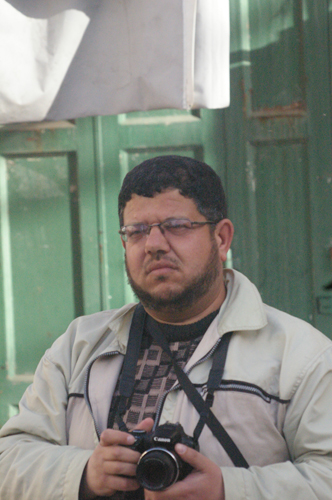 A photographer from B'Tselem helping to heighten the tension between Jews and Arabs in Hebron.