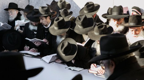 Chabad rabbis at the gravesite of the Lubavitcher Rebbe, in Queens, New York Friday, Nov. 21, 2014. (AP Photo/Chabad.org, Adam Ben Cohen)