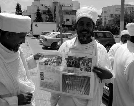 Qessotch (Beta Israel priests) with a newspaper article on the Sigd, following a meeting in Kiryat Malakhi of the Council of kohanim of the Ethiopian Jews in Israel. Photo - Shai Afsai
