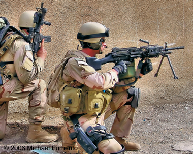 Navy Petty Officer 2nd Class (Sea, Air, and Land) Michael Monsoor in combat in Ramadi, 2006