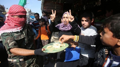 Sweets handed out in Gaza to celebrate the synagogue attack. (Photo credit: Reuters)