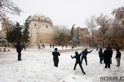playing in the snow in jerusalem