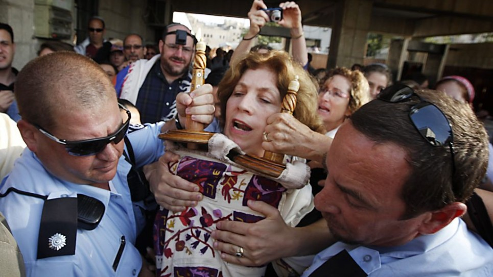 Police escort Anat Hoffman holding a Torah scroll from the Western Wall, on July 12, 2010. (photo credit: Miriam Alster/Flash90)