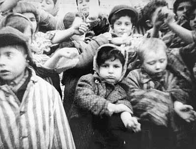 Children at Auschwitz - show their number- tattooed arms to the photographer.