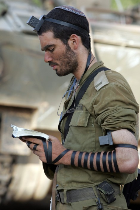 "An Israeli soldier during his morning prayers. How many love languages are being used? (""IDF soldier put on tefillin"" by Yoavlemmer - Own work. Licensed under GFDL via Wikimedia Commons.)"