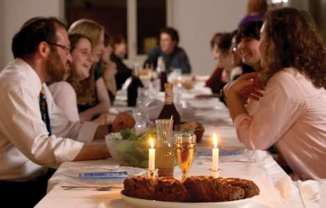 smiling people at shabbat dinner