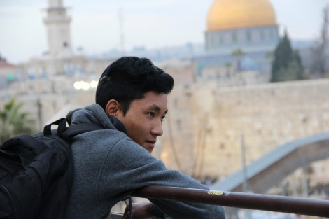 A young man gazes before approaching the Kotel for the first time - Photo credit: Laura Ben-David