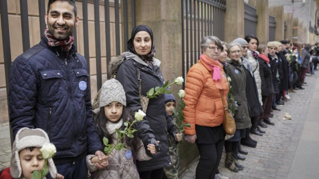 "Danish people of Muslim, Jewish and Christian faith form a peace ring around the synagogue in Copenhagen, Saturday, March 14, 2015. A Jewish security guard was fatally shot there last month. Organizer Niddal El-Jabr says the idea behind the show of unity was to ""send a powerful statement"" that ""Jews should be able to have their religion in peace."" (photo credit: AP Photo/Mads Nissen/Polfoto)"
