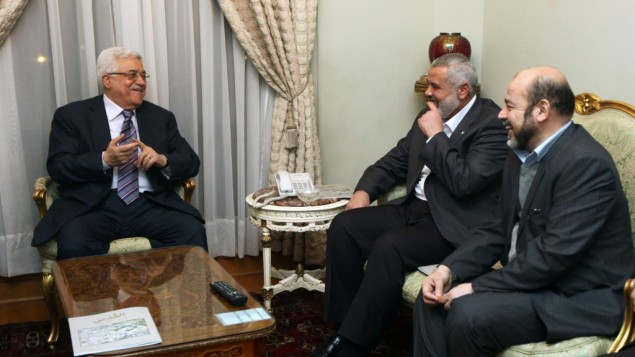 Palestinian President Mahmoud Abbas, and prime minister in gaza strip, Ismael Hanyah, during a meeting between Fatah and Hamas in Cairo, Egypt, 23 February 2012 (photo credit: Mohammed Al-Hums/Flash90)