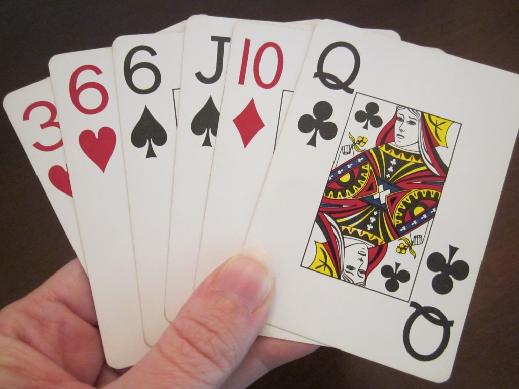 photo of playing cards in hand