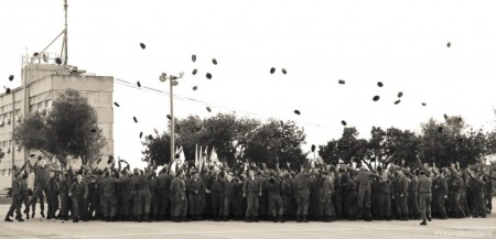 The soldiers mark the end of the ceremony with the traditional tossing berets in the air. Photo credit: Laura Ben-David