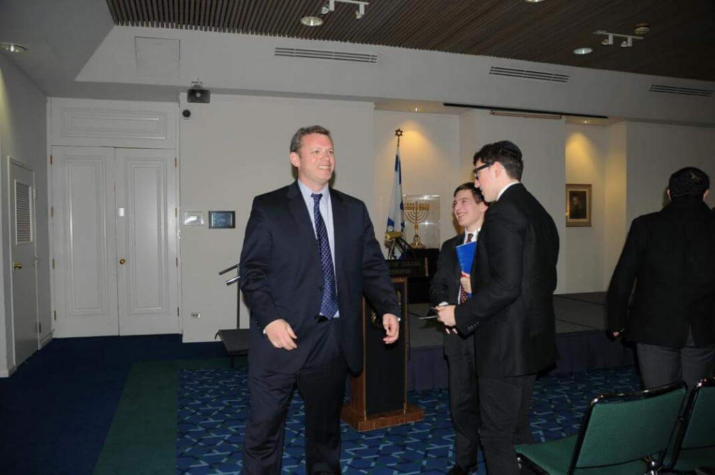 Eli Groner welcoming David Aaronson and several other students to the Embassy of Israel in Washington D.C. in March of 2013