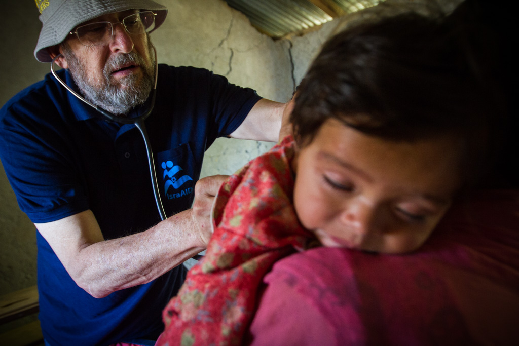 IsraAID's Medical Team Leader, Prof. Mick Elkin, treats babies in the remote Gorkha District.