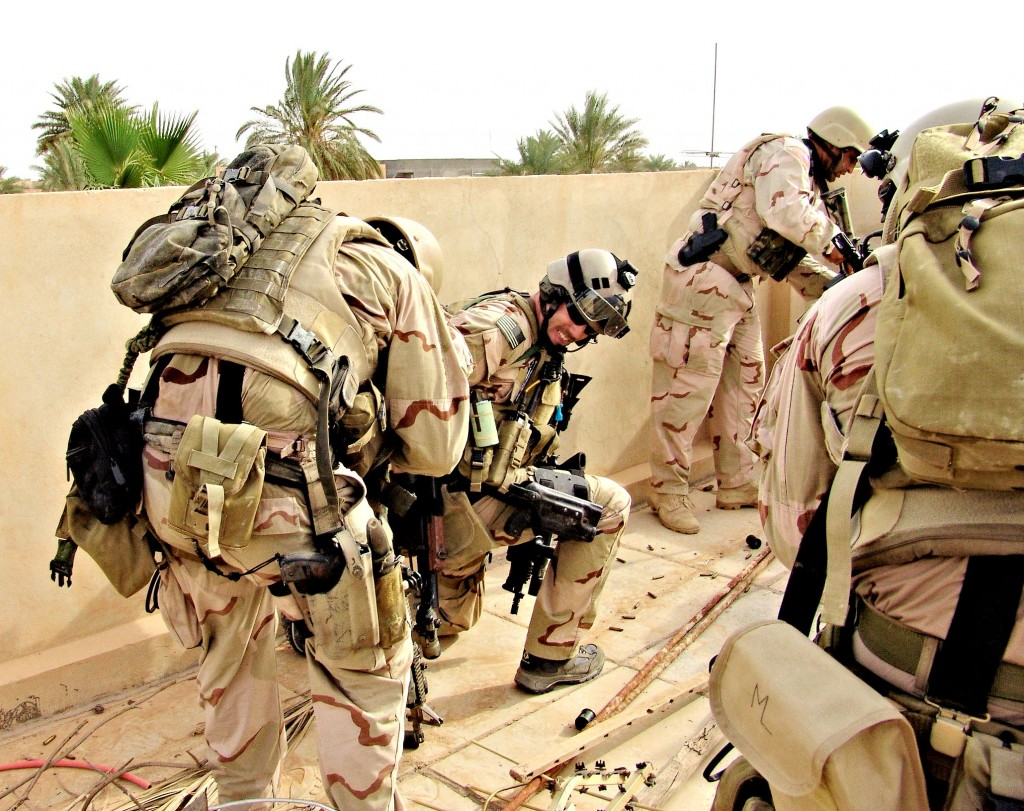 Marc Lee, first SEAL to die in Iraq, on the far right with side pack bearing his initials.