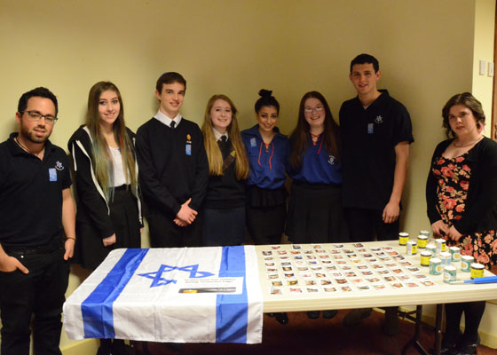UJIA Youth Worker Julie-Rae King with Glasgow youth at the city's Yom Hazikaron ceremony at Giffnock Synagogue.