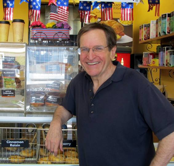 Author and educator Ron Wolfson — in a bagel shop decked out for the holiday — says the Fourth of July is a time to remember.(Edmon J. Rodmon)