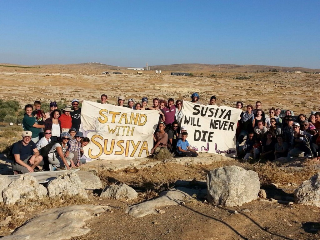 Activists and locals at Susiya. Photo: Rena oppenheimer