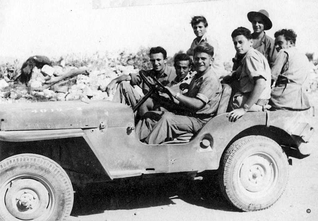 Jordan Valley old-timers during a May Day parade in the 1940s. From the collection of Naftali Oppenheim. (photo credit: Courtesy Bitmuna)