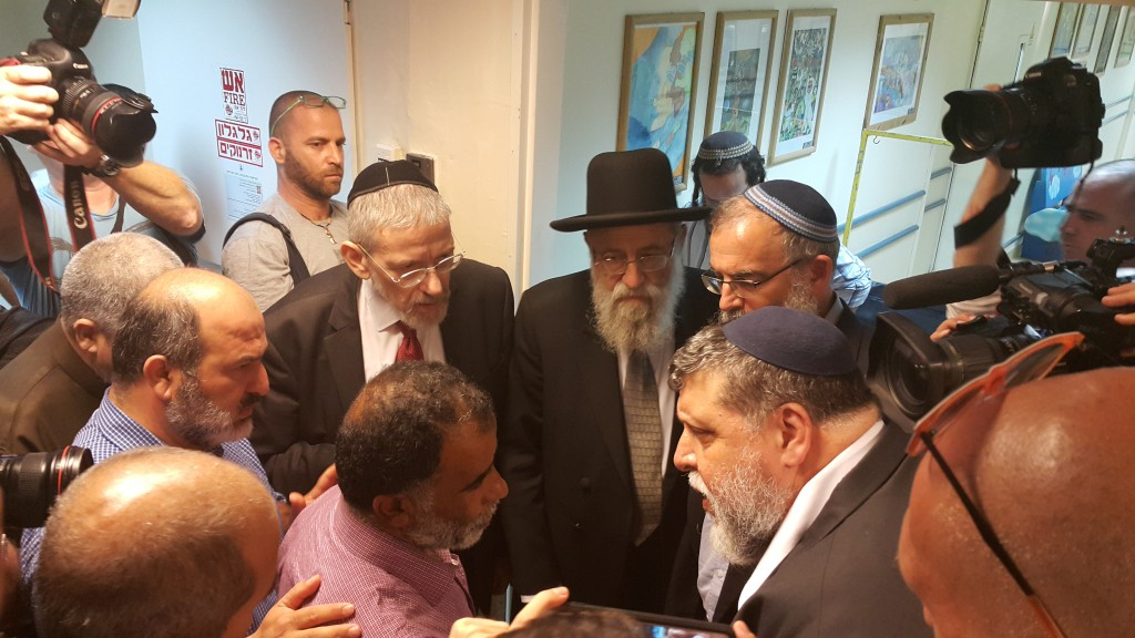 Jewish and Muslim religious leaders meeting with the grandfather of the burn victims at Sheba Medical Center, Tel Hashomer