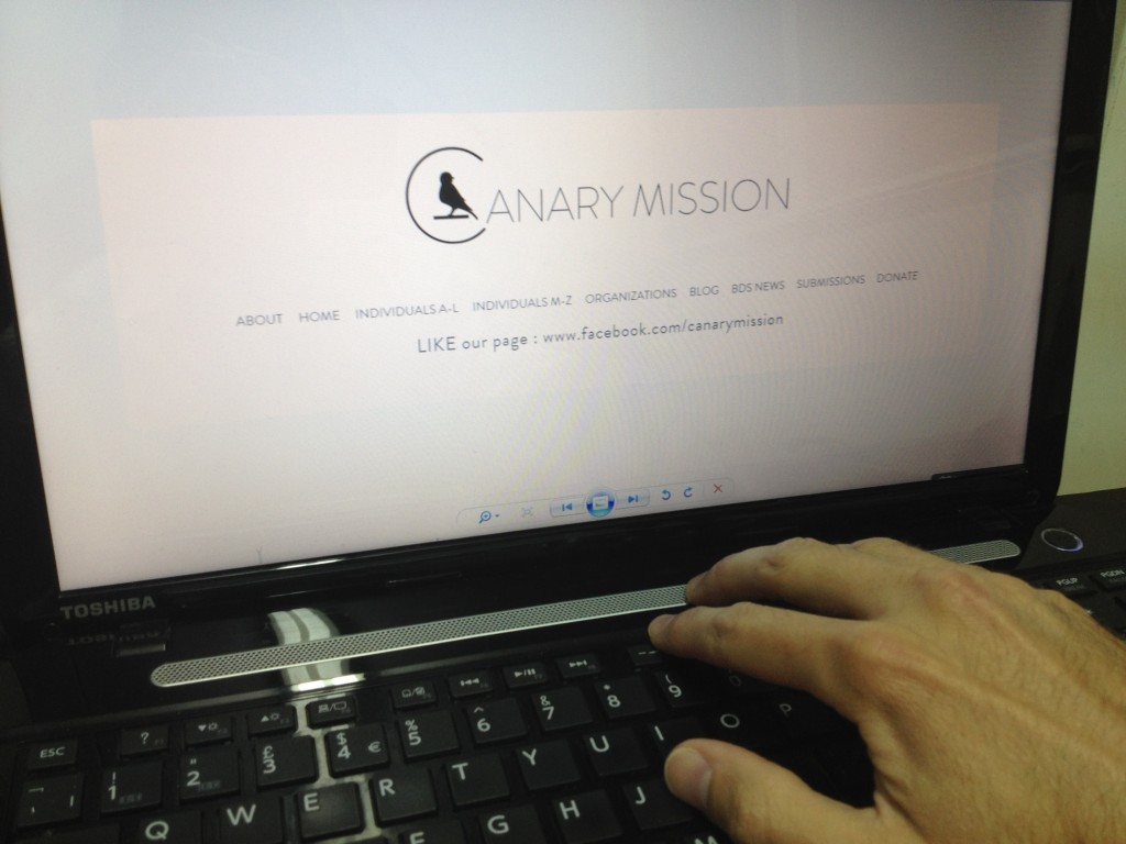 A staffer in the Canary Mission office prepares to check a profile. (Edwin Black)