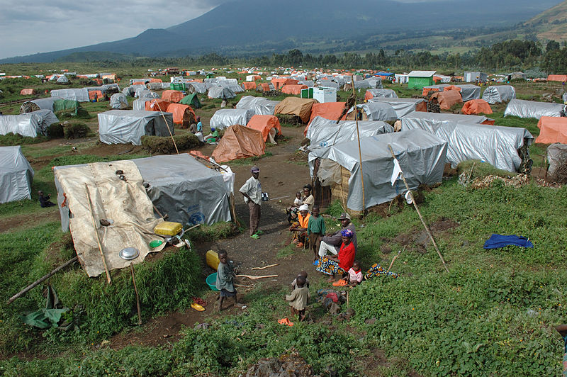 Refugee camp in Congo {By Julien Harneis [CC BY-SA 1.0 (http://creativecommons.org/licenses/by-sa/1.0) or CC BY-SA 2.0 (http://creativecommons.org/licenses/by-sa/2.0)], via Wikimedia Commons}