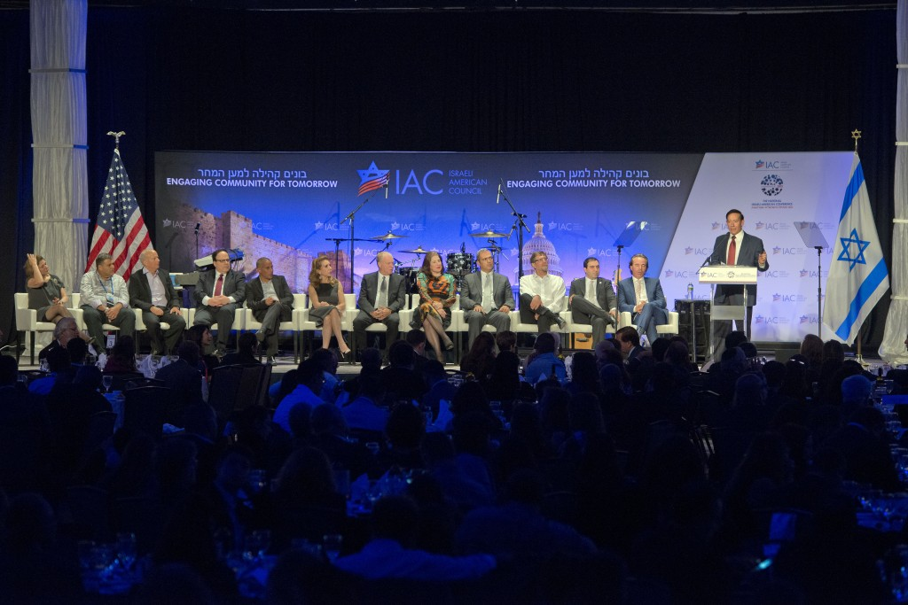 Adam Milstein accepting the position of National Chair, at 2015 IAC Convention,with board on stage (Shahar Azran)