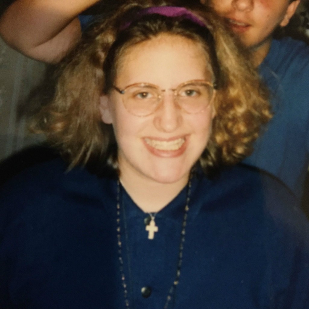 The writer, then known as Amanda Elizabeth Borschel, with Eighties hair, glasses and retainer -- and the silver crucifix given to her by her mother. (courtesy)