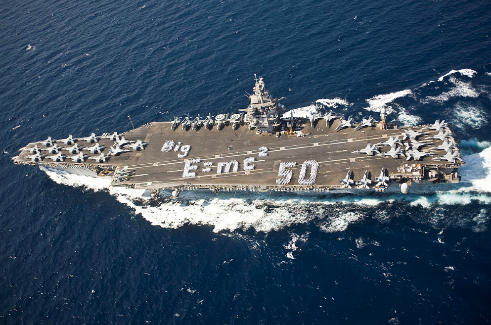 (U.S.S. Enterprise with sailors spelling out Einstein's Equation -- Wikimedia Commons)