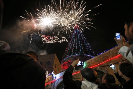 Fireworks light the sky during a Christmas tree lighting ceremony in Jerusalem's Old City