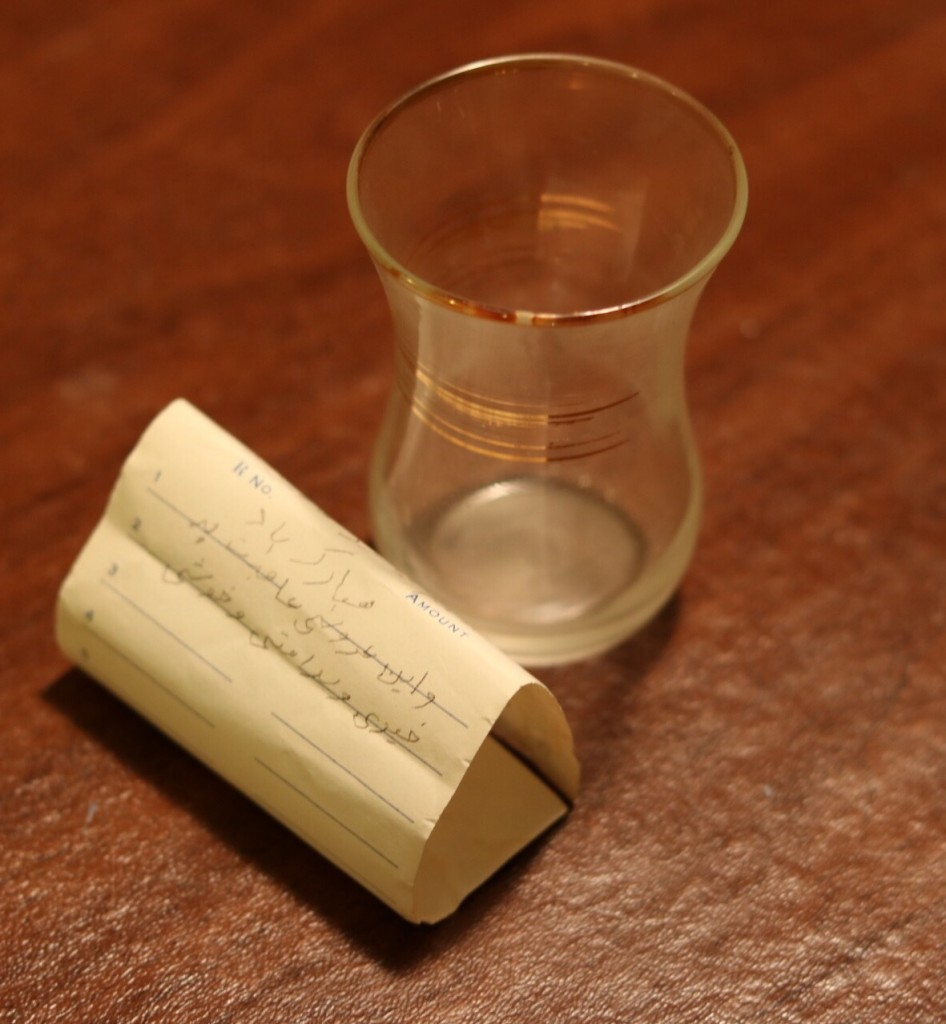 The glass cup and note