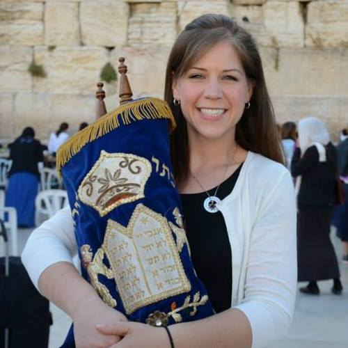 The author with a Torah scroll at the Western Wall.