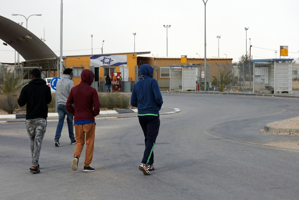Asylum Seeker walking towards the entrance of Holot. Photo: Becca Strober