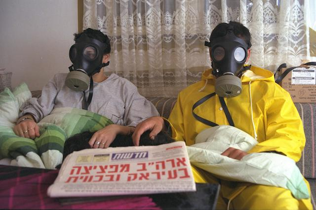 "AN ISRAELI FAMILY IN ITS SEALED ROOM, WITH GAS MASKS, DURING AN ALARM. ÓÏÁÓ˙ ‰ÓÙ¯ı. ·ˆÈÏÂÌ, Ó˘ÙÁ‰ È˘¯‡ÏÈ˙ ·Á""¯ ‰‡ËÂÌ, ÚÌ ÓÒÎÂ˙ ‡·""Î ÚÏ ÙȉÌ, ·Ó‰ÏÍ ‡ÊÚ˜˙ ÁȯÂÌ."