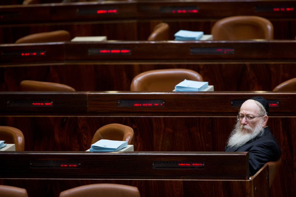After waiting alone for an hour Health Minister Dov Litzman realizes it is Friday and the Knesset is closed for the weekend. (Yonatan Sindel/Flash90)