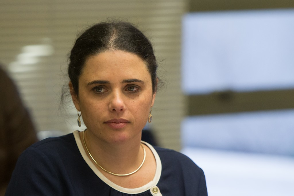 Justice Minister Ayelet Shaked shares an amusing anecdote with other lawmakers. (Yonatan Sindel/Flash90)