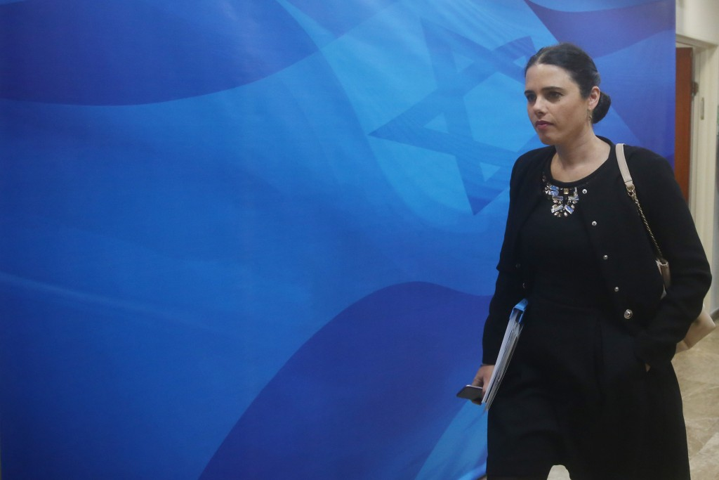 Justice Minister Ayelet Shaked makes her merry way to the weekly cabinet meeting. (Marc Israel Sellem/POOL)