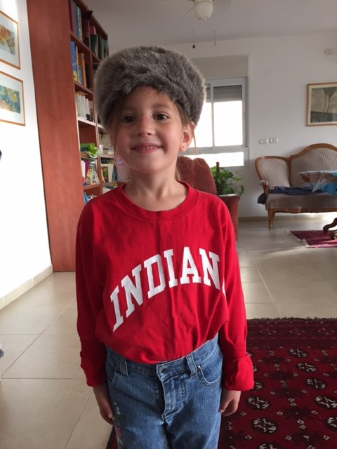 The five year old as an 'American' on dress-as-a-nation day. Note the fake raccoon tail hat. (Amanda Borschel-Dan)