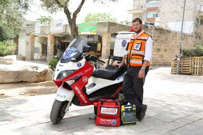 Yossi and his Ambucycle (Photo credit: United Hatzalah Media Department)