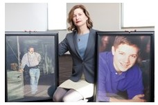Mindy Corporan with photos of her father, William, and son, Reat (Photo by Jeremey Theron Kirby)