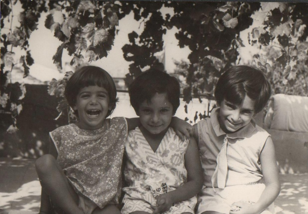 Enjoying the shade underneath a canopy of grapevines (Ilana on the left together with cousins Michal and Chagit).