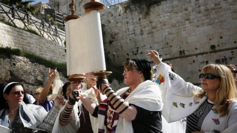 Religious Jewish women which are part of the Women of the Wall organization wear tfillin (prayer shawls) and tallit as they read from the Torah and pray at Robinson's Arch, near the Western Wall in Jerusalem. The WOW organizes women's prayer groups at the Western Wall at the start of every new Jewish month (Rosh Hodesh). Jewish ultra orthodox communities oppose women's singing in the presence of men, reading from the Torah, and wearing the ritual garments and objects traditionally associated with men. March 12, 2013. Photo by Miriam Alster/FLASH90 *** Local Caption *** ðùåú äëåúì èìéú ðùéí úåøä