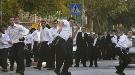 JERUSALEM, ISRAEL ? NOVEMBER 6: (ISRAEL OUT) Ultra-Orthodox Jewish men throw stones during a protest against the upcoming Gay Pride parade November 6, 2006 in Jerusalem, Israel. Religious leaders from both the Jewish and Muslim communities have called out against the parade, due to take place in Jerusalem next Friday. (Photo by Uriel Sinai/Getty Images)